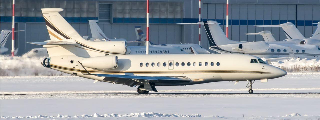 A Dassault Falcon 7X on a snowy runway